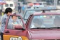 Didi Kuaidi's Hitch service effectively lets one passenger pick up another to share costs and network. The company plans to match passenger profiles so users can select co-riders they are most likely to get on with for a more enjoyable commute across China's congested urban spreads. Photo: SCMP Pictures
