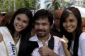 Filipino boxing icon Manny Pacquiao says he is hanging up his gloves to 'focus on my other big responsibility in my daily life, to help the people' after his final fight against Timothy Bradley. Photo: EPA