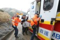 Emergency services assist those in danger of succumbing to hypothermia on Tai Mo Shan this morning. Photo: Felix Wong