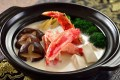 Alaskan king crab with soy milk and assorted vegetables in clay pot, available at Regal hotels.