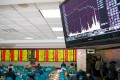 A screen showing stock information is seen at a brokerage house in Nanjing, Jiangsu province on January 26, 2016. China stocks plunged more than 6 per cent on Tuesday after yet another late bout of panic selling triggered by a resumed slide in global equity markets and oil prices. Photo: Reuters