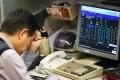 Hong Kong's benchmark Hang Seng Index opened Tuesday down 1.4 per cent. Photo: Sam Tsang