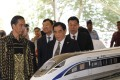 Indonesian President Joko Widodo with Sheng Guangzu, general manager of China Railway Corp, at the groundbreaking ceremony for the Jakarta-Bandung fast-train railway line in Indonesia last week. Construction for the project has since been stalled. Photo: Reuters