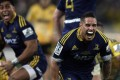 Highlanders Malakai Fekitoa and Aaron Smith celebrate winning the 2015 Super Rugby final against the Wellington Hurricanes. Photo: AFP