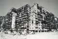 Kowloon Walled City makes an appearance in one story in Tales of Two Cities.