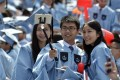 Chinese graduates of Columbia University attend a commencement ceremony in New York. Photo: Xinhua