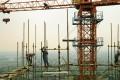 Builders work on a construction site in Huzhou, Zhejiang province. Photo: Xinhua