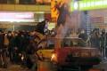 Rioters throw bricks at police in Mong Kok. Photo: AP