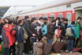 Passengers board a train during the Lunar New Year travel rush at a railway station in Guilin, Guangxi Zhuang Autonomous Region. Photo: Reuters