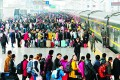 Passengers wait to board a train at a railway station during the Chinese Lunar New Year travel rush, in Jiujiang, Jiangxi province. Photo: Reuters