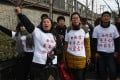 Investors in Chinese online peer-to-peer lender Ezubao chant slogans during a protest in Beijing on February 4. Photo: AFP