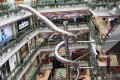 The enclosed slide wends its way down five floors of the Printemps Mall in Shanghai. Photo: SCMP Pictures