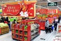 Nanjing residents shop for groceries at a supermarket ahead of the Lunar New Year. Photo: Xinhua