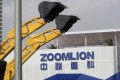 A Zoomlion company logo is seen next to its excavators at an exhibition in Shanghai, in this November 29, 2012 file photo. Photo: Reuters