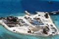 Aerial view of construction at Mabini (Johnson) Reef by China, in the disputed Spratley Islands, in the south China Sea. China deployed two batteries of sophisticated surface-to-air missile launchers to a disputed island in the South China Sea yesterday. Photo: EPA