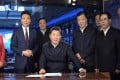 President Xi Jinping sits in the presenter's chair of Xinwen Lianbo, the 7pm prime-time news programme, surrounded by two hosts and other officials in the CCTV studio. Photo: Simon Song