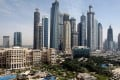 View of luxury hotels and skyscrapers in Dubai. The strength of the US dollar, to which the dirham is linked, has also hurt demand from Dubai's traditional customers in Europe and Russia. Photo: EPA