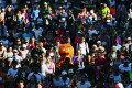 A participant dressed as a gingerbread man races in the annual 'City 2 Surf Fun Run' in Sydney. The uphill battle for young aspiring home owners is most apparent in Sydney where the median home costs 12.2 times the median annual pretax household income. Photo: Reuters