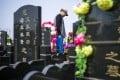 A man prays on the eve of the 2015 Qingming festival, or Tomb Sweeping Day, at a cemetery in Dagantangcun, China. Photo: AFP