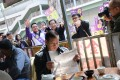 Straining to get the attention of every voter in the New Territories East by-election. Photo: SCMP Pictures