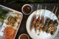 Pork meatball and Mayura Wagyu beef skewers with condiments from Le Garcon Saigon. Photos: Jonathan Wong