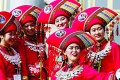 Women wearing ethnic minority costumes take selfies outside the Great Hall of the People during the opening session of the National People's Congress (NPC) in Beijing, China. Photo: Reuters
