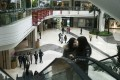 Visitors look around a shopping mall in Beijing. Photo: AFP