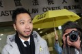 Activist Ken Tsang, who was allegedly beaten by police, also faces a charge of assaulting and resisting officers. Photo: K. Y. Cheng