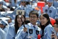 Chinese graduates of New York's Columbia University attend the commencement ceremony. Photo: Xinhua