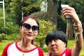 Shen Hui Hui (right), 20, takes a selfie with her idol Shen Man (left) in matching shirts at a fan meeting in Hangzhou in 2015.