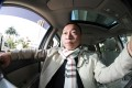 Uber driver William Wong Ka-lok in his car in Sha Tin. Photo: Bruce Yan