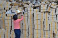 China's logistics industry is witnessing a reshuffling of the position of its major players, which began in 2015. Photo: Xinhua (151111) -- GUANGZHOU, Nov. 11, 2015 (Xinhua) -- Workers sort out packages at a sorting center in Guangzhou, capital of south China's Guangdong Province, Nov. 11, 2015. The Singles' Day Shopping Spree, or Double-11 Shopping Spree, Chinese equivalent of Cyber Monday or Black Friday, is an annual online shopping spree falling on Nov. 11 for Chinese consumers since 2009. Each year the express delivery industry will face package peak after the shopping spree. (Xinhua/Liang Xu)(wjq)