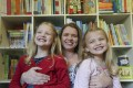 Sara Young at home in Pok Fu Lam with her two daughters Sophie (left), 8, and Jessica (right), 5. Photo: Edward Wong