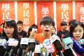 Joshua Wong (centre) sets out what will happen to student group Scholarism. Photo: Felix Wong
