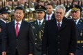 Chinese President Xi Jinping (left) and his Czech counterpart Milos Zeman inspect the guard of honour at Prague Castle in Prague, Czech Republic, on Tuesday. Photo: EPA
