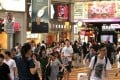 Shoppers in Russell Street Causeway Bay Hong Kong . Local retailers are operating under tougher business conditions this winter.