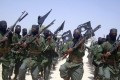 Al-Shabab fighters march with their weapons during military exercises on the outskirts of Mogadishu in 2011. Photo: AP