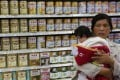 A file picture of a woman and baby shopping for milk powder in Beijing. Photo: Reuters
