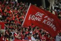 A Hong Kong football fan waves a flag during a world cup qualifier at Mong Kok Stadium last year. Hong Kong fans booed the anthem they share with China while some turned their backs in a show of defiance. Photo: AFP
