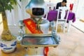 The use of four robot waiters in one restaurant in the city of Xiamen made national headlines. Photo: Xiamen Daily
