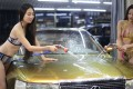 Girls in bikinis wash cars in Taiyuan, the capital of north China's Shanxi province, in this July 2014 file photo. O2O service providers like Bopai that offer routine car-washing services have been dropping like flies in China since last year. Photo: SCMP Pictures