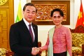 Chinese Foreign Minister Wang Yi and his Myanmese counterpart Aung San Suu Kyi shakes hands in Myanmar's capital on April 5, 2016. Photo: Xinhua