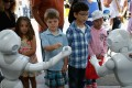 POMONA, CA - JUNE 06: Children interact with Aldebaran's Pepper robot during the Defense Advanced Research Projects Agency (DARPA) Robotics Challenge Expo at the Fairplex June 6, 2015 in Pomona, California. Organized by DARPA, the Pentagon's science research group, 24 teams from aorund the world are competing for $3.5 million in prize money that will be awarded to the robots that best respond to natural and man-made disasters. Chip Somodevilla/Getty Images/AFP == FOR NEWSPAPERS, INTERNET, TELCOS & TELEVISION USE ONLY ==