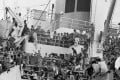 Vietnamese refugees crowd aboard the Military Sealift Command ship Pioneer Contender after fleeing Vietnam in 1975. Photo: AP