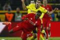 Liverpool's Divock Origi is fouled by Borussia Dortmund's Sokratis Papastathopoulos. Photo: Reuters