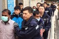 Illegal immigrants held in a joint operation. Photo: SCMP Pictures
