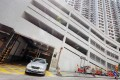 A car leaves the car park at a private residential development in Tai Hang. Photo: Nora Tam