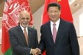 A file photo of Chinese President Xi Jinping (right) with his Afghan counterpart Ashraf Ghani . Photo: Xinhua