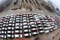 More than 300 cars wait to be loaded onto a cargo ship for export at a port in Lianyungang, Jiangsu province. Photo: Xinhua