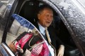 Republican presidential candidate Governor John Kasich of Ohio talks to reporters from his car after delivering a speech at the Women's National Republican Club in New York on Tuesday. Photo: EPA